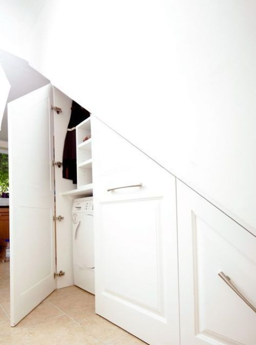 Built-In Laundry Space Under The Stairs With Much Storage