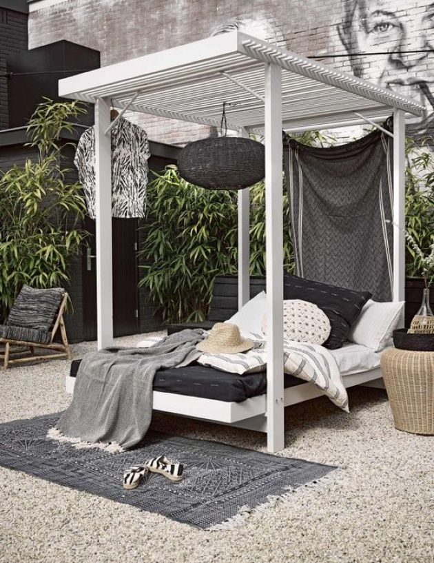 Cabana-Style Wooden Daybed With A Hanging Black Lamp