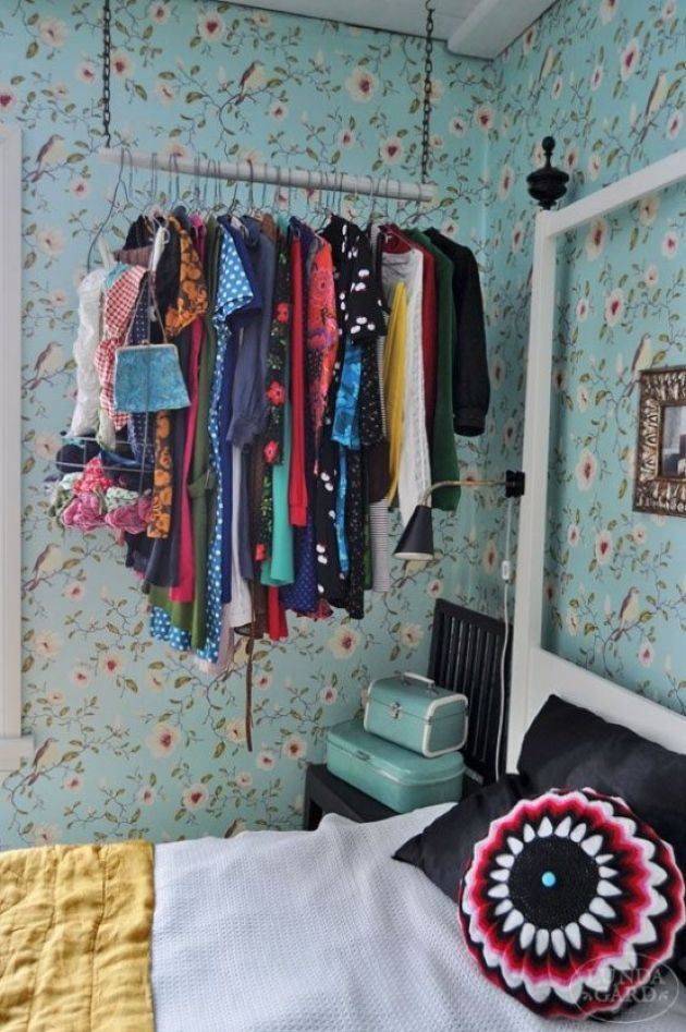 Chain And Wood Stick Closet With Clothes Hangers