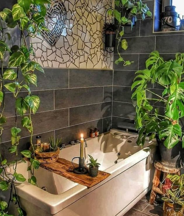 Chic Boho Bathroom With Mosaics On The Wall And Potted Greenery Plus A Wooden Caddy