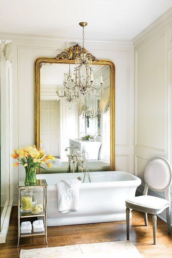 Chic Parisian Bathroom With A Statement Mirror In A Gilded Frame
