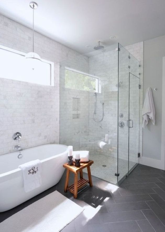 Chic Transitional Space With Marble And Grey Tiles And Contemporary Oval Tub