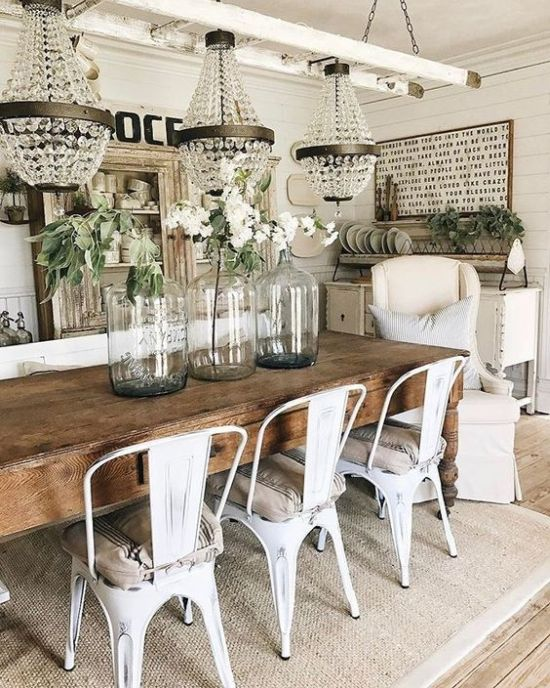 Chic Vintage Farmhouse Dining Area With Crystal Chandeliers And Sign Plus Shabby Chic Buffet And Wooden Table And Metal Chairs