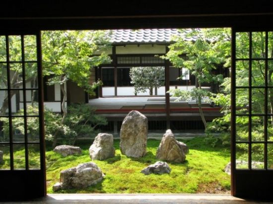 Classic Japanese Garden With Grass And Large Rocks