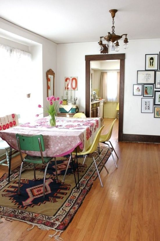 Colorful Boho Dining Space With A Hairpin Leg Table And Mismatching Chairs