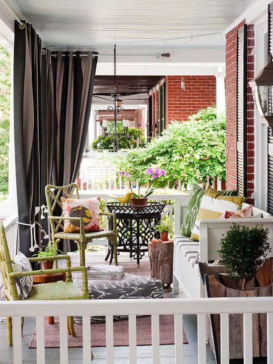 Colorful Summer Porch With Yellow Rattan Chairs
