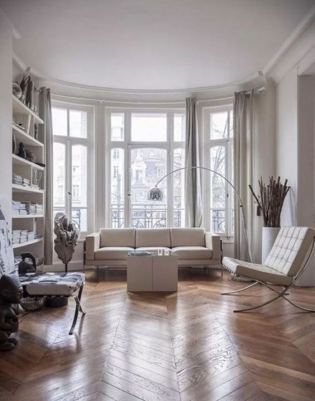 Contemporary Parisian Living Room With All-Whites And A Hardwood Parquet Floor