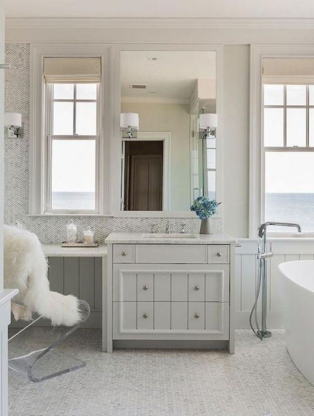 Contemporary Tub With Sea Views And Contemporary Vanity Plus An Acrylic Chair