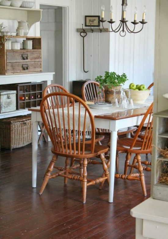 Cozy Farmhouse Dining Space With Wooden Table Plus Orange Chairs And Large Vintage Buffet
