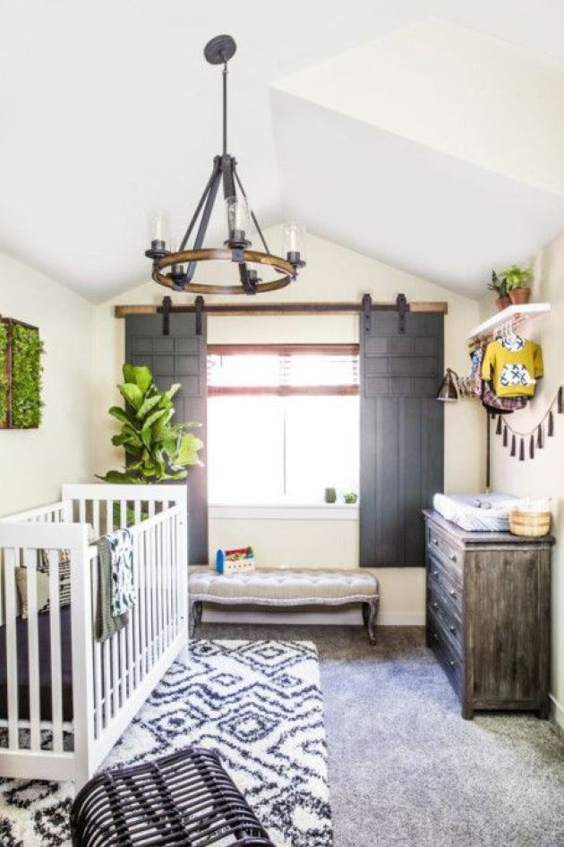 Cozy Rustic Nursery With A Tassel Garland And Printed Rugs
