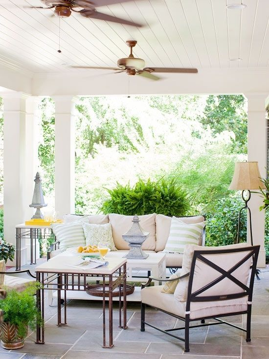 Cozy Summer Porch With Ceiling Fans And Comfy Upholstered Furniture