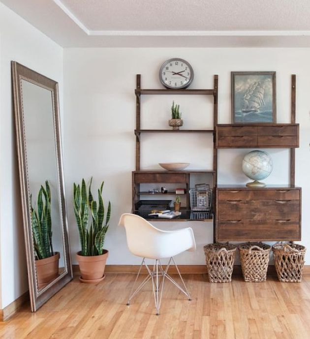 Dark Stained Wall Unit With Open Shelves Plus A Bureau With A Desk And Drawers