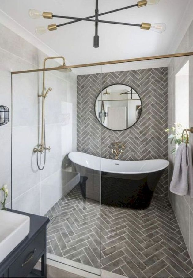 Elegant Parisian Bathroom With Grey Tiles And Black Tub