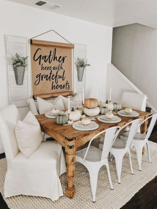 Fall Modern Farmhouse Dining Room With A Sign And Metal Planters Plus A Wooden Table And Metal And Upholstered Chairs