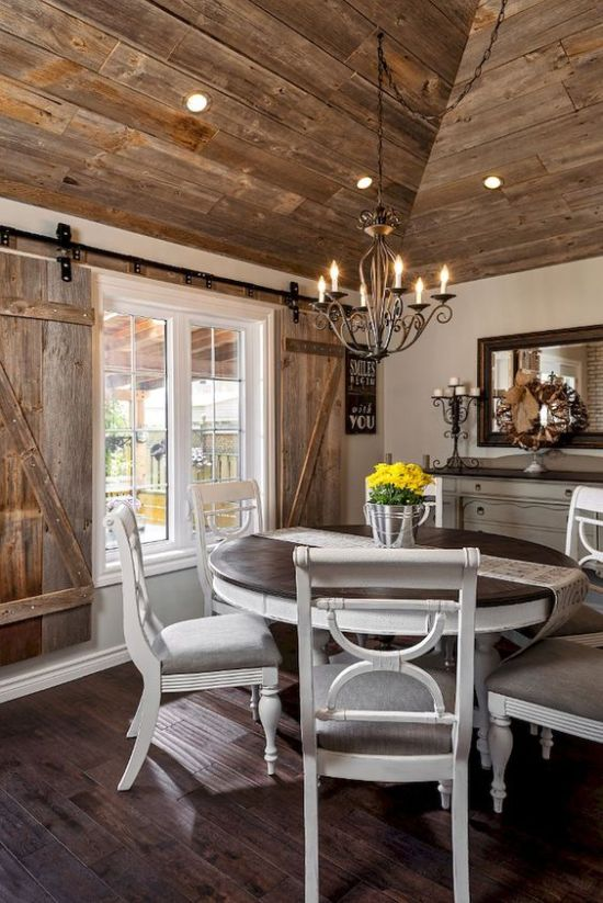 Farmhouse Wooden Dining Area With Shutters Plus Vintage White Furniture And A Framed Mirror