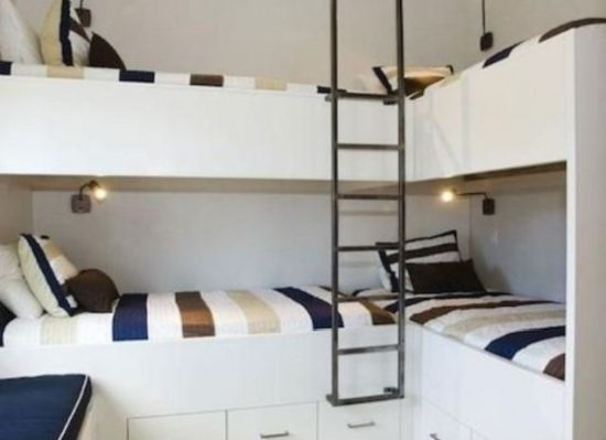 Four Kids Bunk Beds With Small Wall Sconces And A Single Ladder