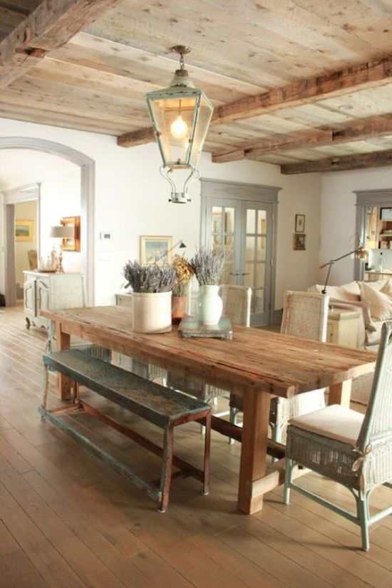 French Farmhouse Dining Space With Wooden Table And Patina Chairs Plus Benches And Lantern