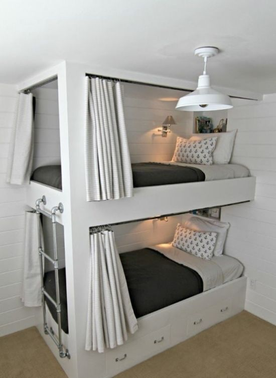 Kids Bunk Bed Unit With A Metal Ladder And Drawers