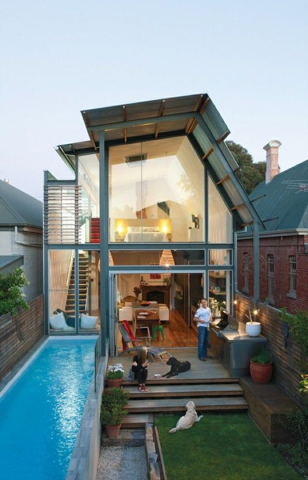 Leveled Backyard With A Lawn And A Narrow Pool