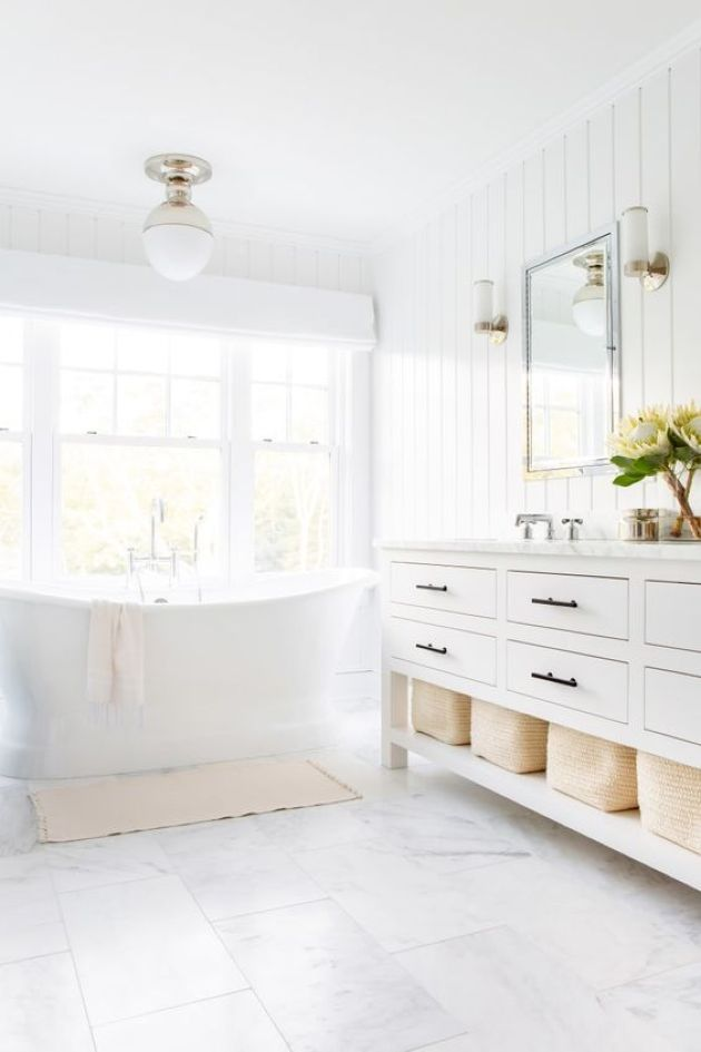 Light-Filled Transitional White Bathroom With A Traditional White Vanity