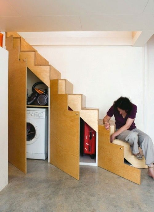 Little Laundry And A Storage Space Under Stair