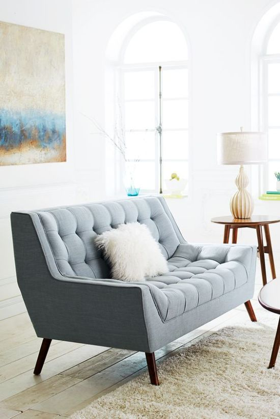 Lovely Powder Blue Loveseat With A Fluffy Pillow For A Mid-Century Modern Interior