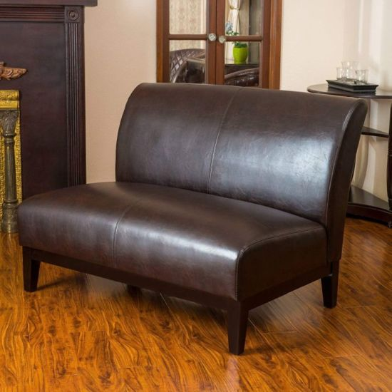 Loveseat Of Brown Leather With Stained Wooden Legs