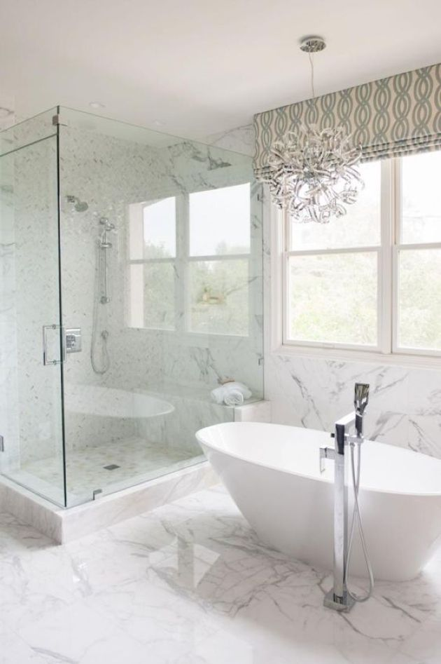 Luxurious Transitional Space With A Fantastic Chandelier And Oval Tub