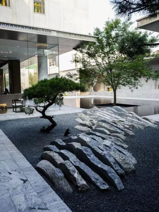 Minimalist Japanese Courtyard With A Rock