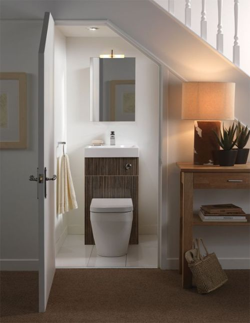 Minimalist Powder Room With A Mirror And A Sink Plus Toilet Combo