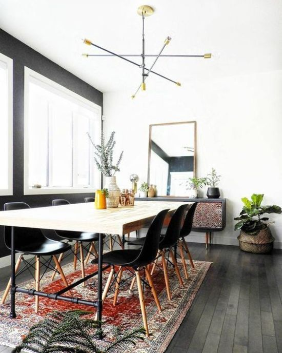 Modern Boho Dining Space With A Sleek Wooden Table And Black Chairs