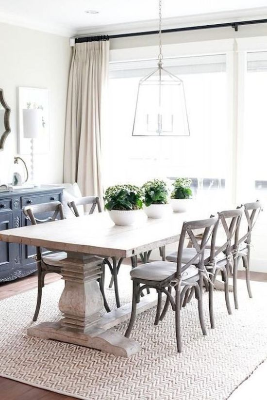 Modern Farmhouse Dining Room With A Whitewashed Table And White Chairs Plus A Frame Lamp And A Buffet