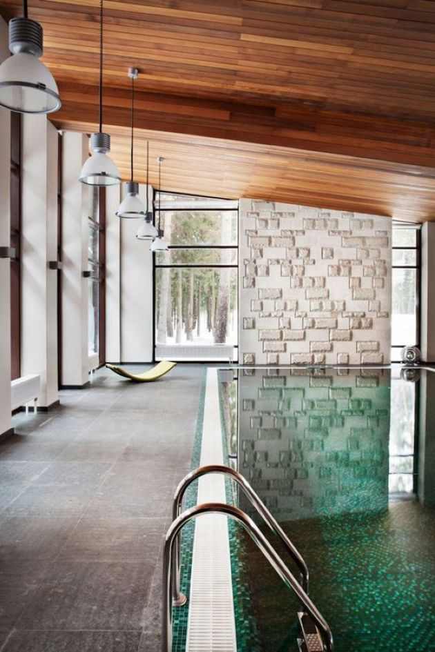 Modern Indoor Swimming Pool With A Tiled Deck