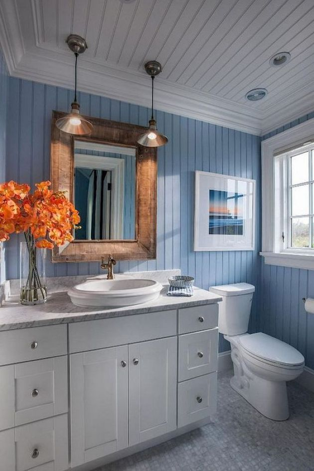Modern Sea-Inspired Bathroom With A White Vanity And Wooden Frame Mirror
