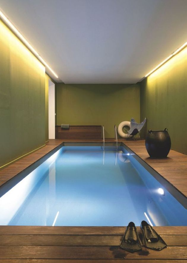 Modern Simple Indoor Pool With A Wooden Deck