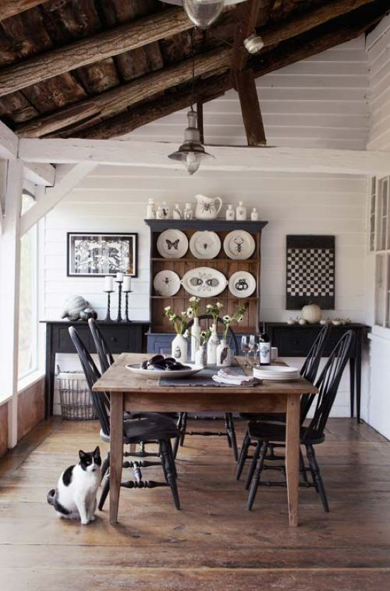 Monochromatic Farmhouse Dining Space With A Black And Stained Wooden Furniture
