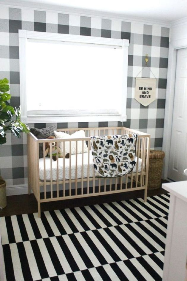 Monochromatic Nursery With A Plaid Wall And A Striped Rug Plus Potted Plants