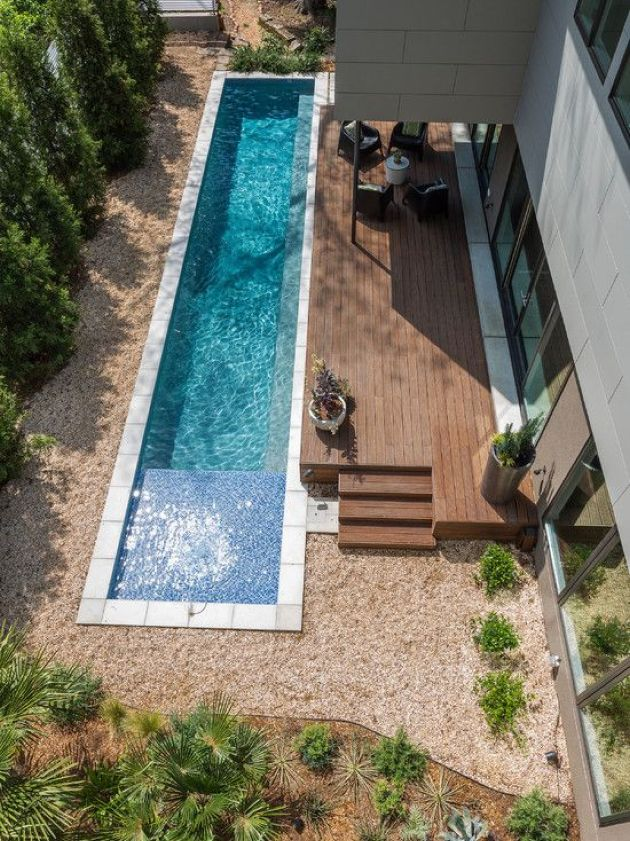 Narrow Backyard Pool Clad With White Tiles