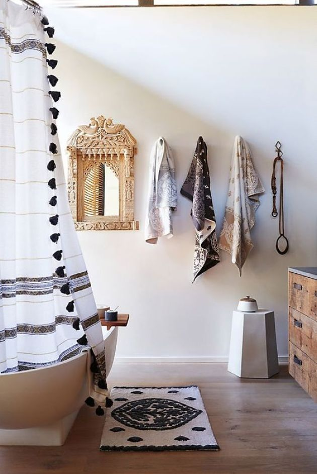 Neutral Bathroom With A Boho Rug And Curtain With Tassels