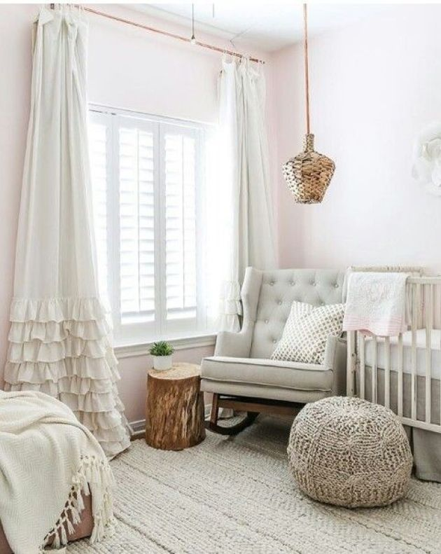 Neutral Nursery Featuring Wicker Accents And Knit And Crochet Elements