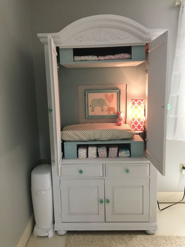 Nursery With Changing Table Plus Storage And Some Additional Light