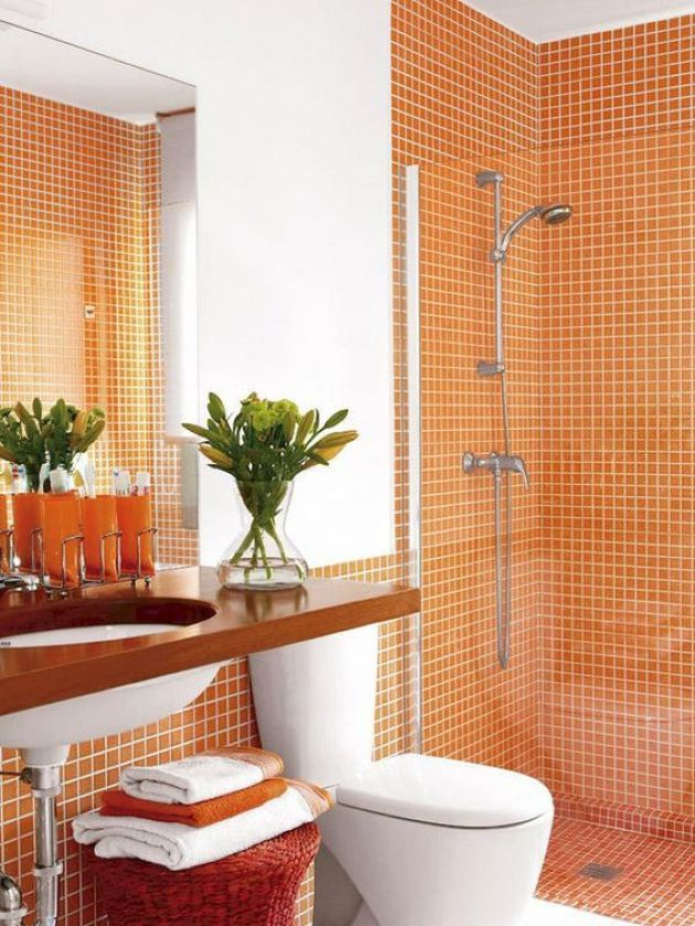 Orange Bathroom With White Grout And Orange Towels