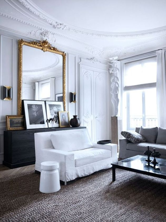 Parisian Living Room With Gorgeous Molding On The Walls And Ceiling