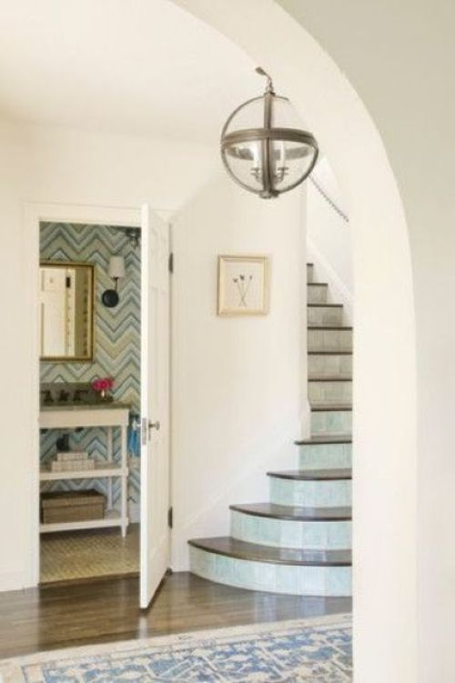 Powder Room Under Stair With Eye-Catchy Geometric Wallpaper And Elegant Mirror