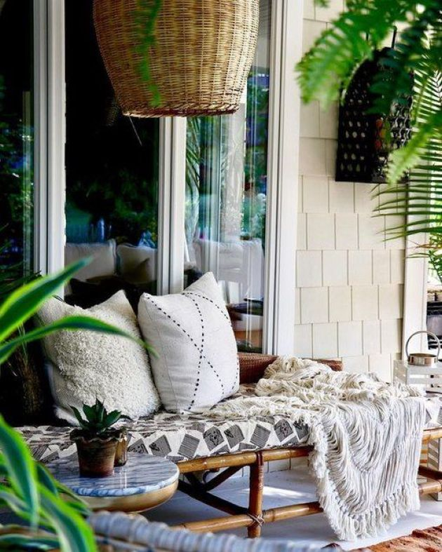 Rattan Daybed With Pillows And A Statement Wicker Lampshade