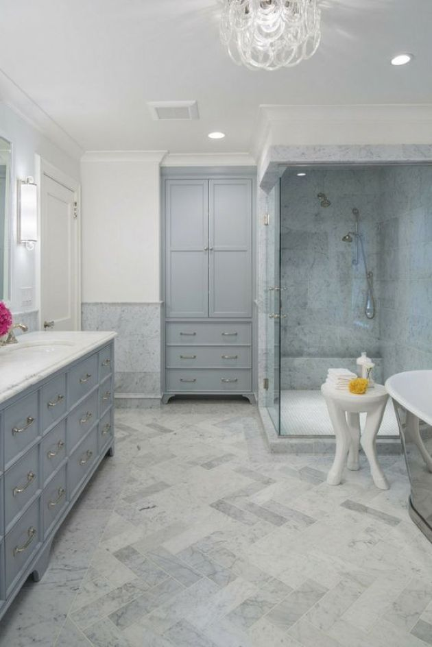 Relaxing Bathroom Done In Greys And Neutrals With A Chic Chandelier
