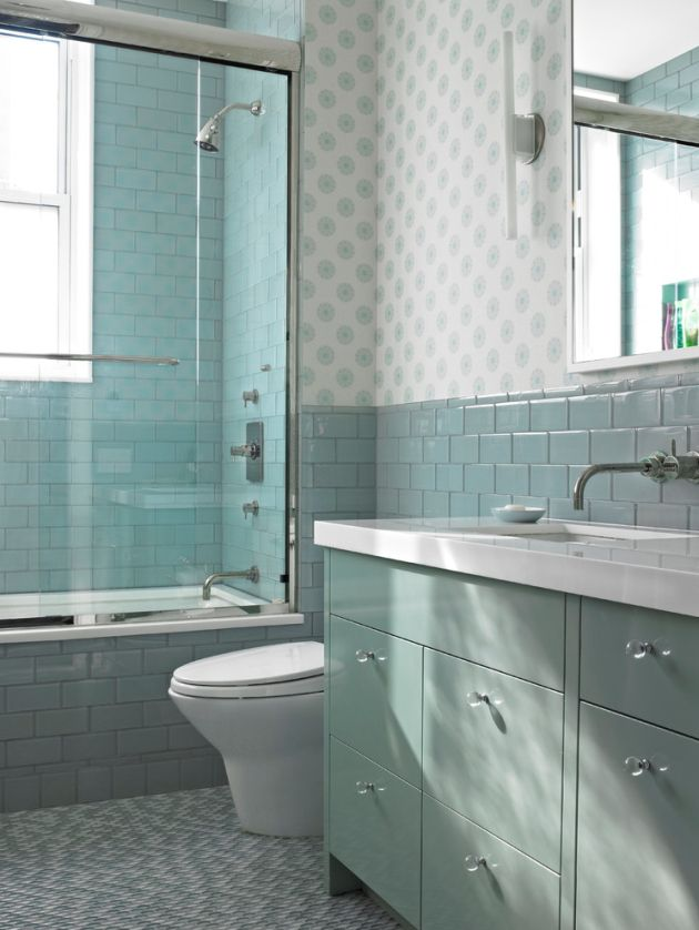 Sea-Inspired Bathroom With Aqua And Turquoise Colored Tiles And Cabinets