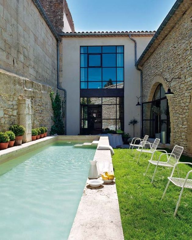 Small Backyard With A Lawn And A Narrow Pool Clad With Tiles