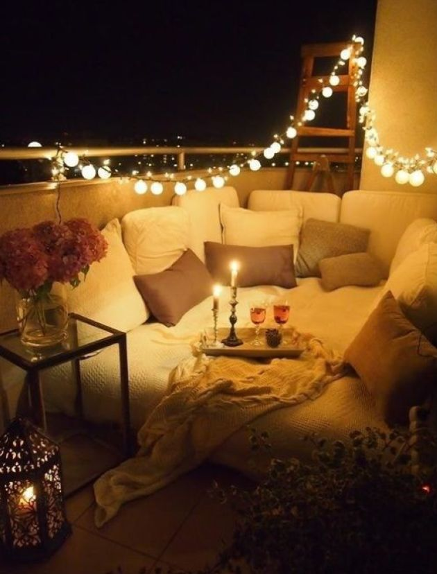 Small Balcony With Lights And Comfy Daybed Plus Floor Pillows