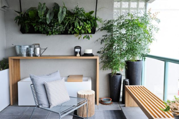 Small Balcony With Potted Plants And Living Walls